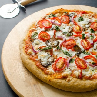 This heathy pizza recipe contains whole wheat pizza crust (low in fat), veggie toppings and homemade pizza sauce.