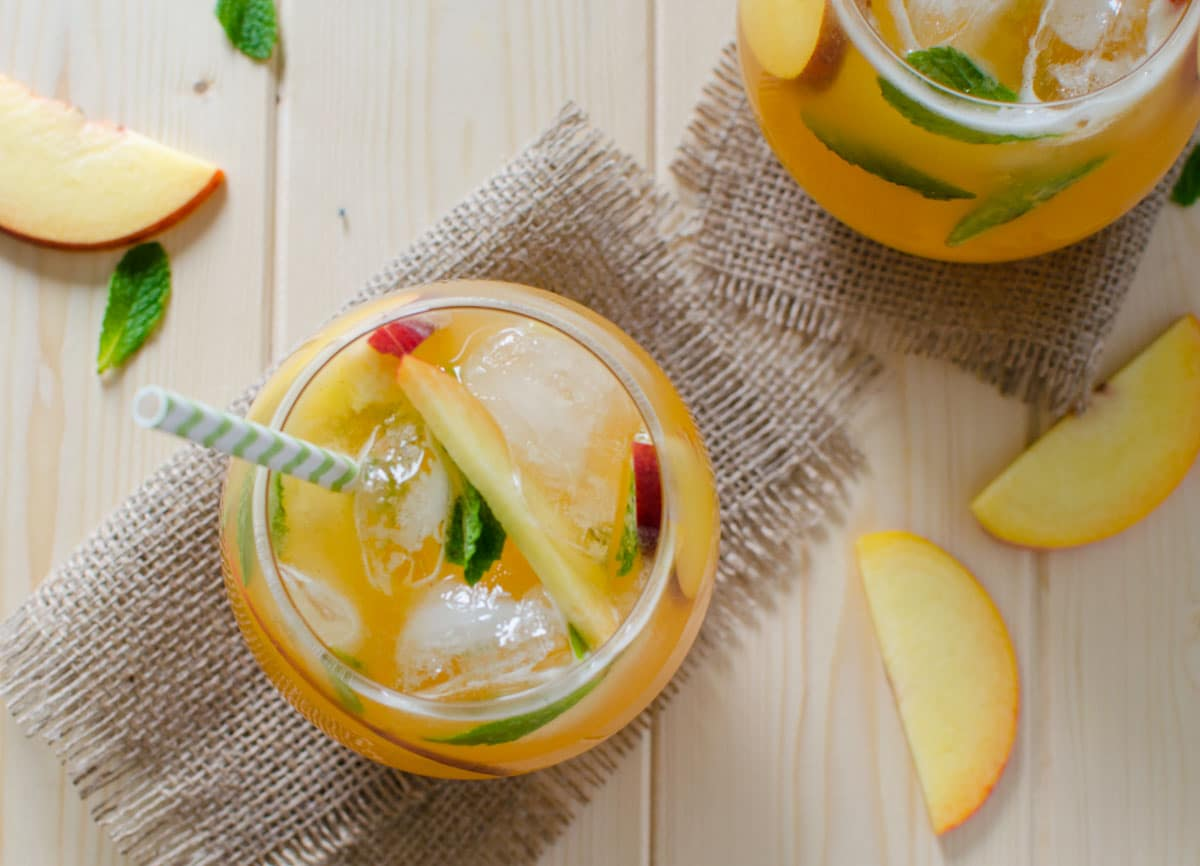 This peach lemonade is a perfect non-alcoholic drink to enjoy seasonal peaches. It is naturally sweetened and kids friendly too.