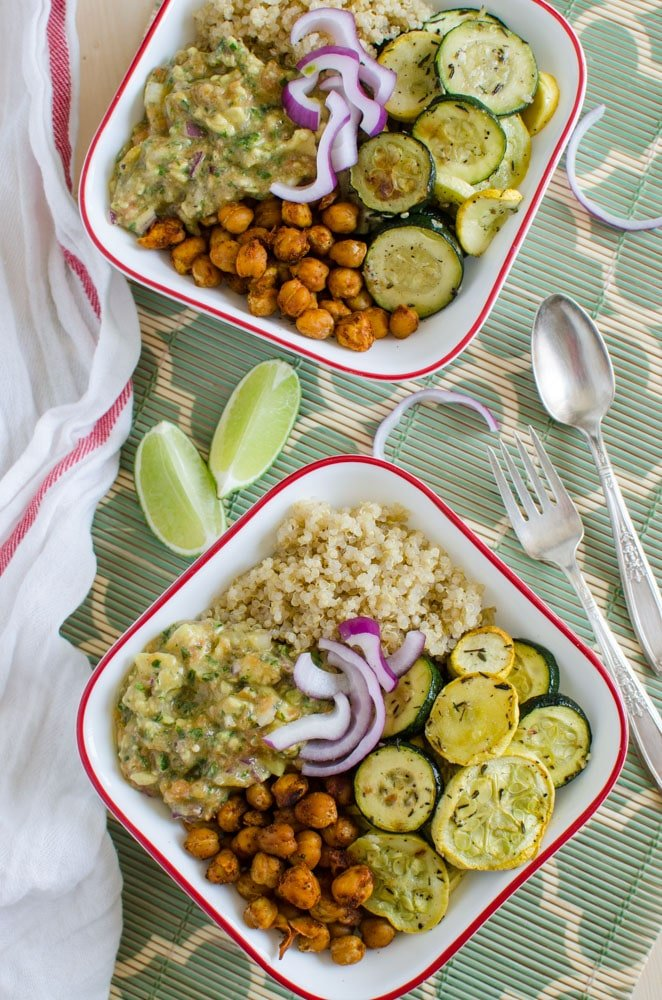 Healthy quinoa bowl that is prepared using roasted veggies like squash and zucchini.