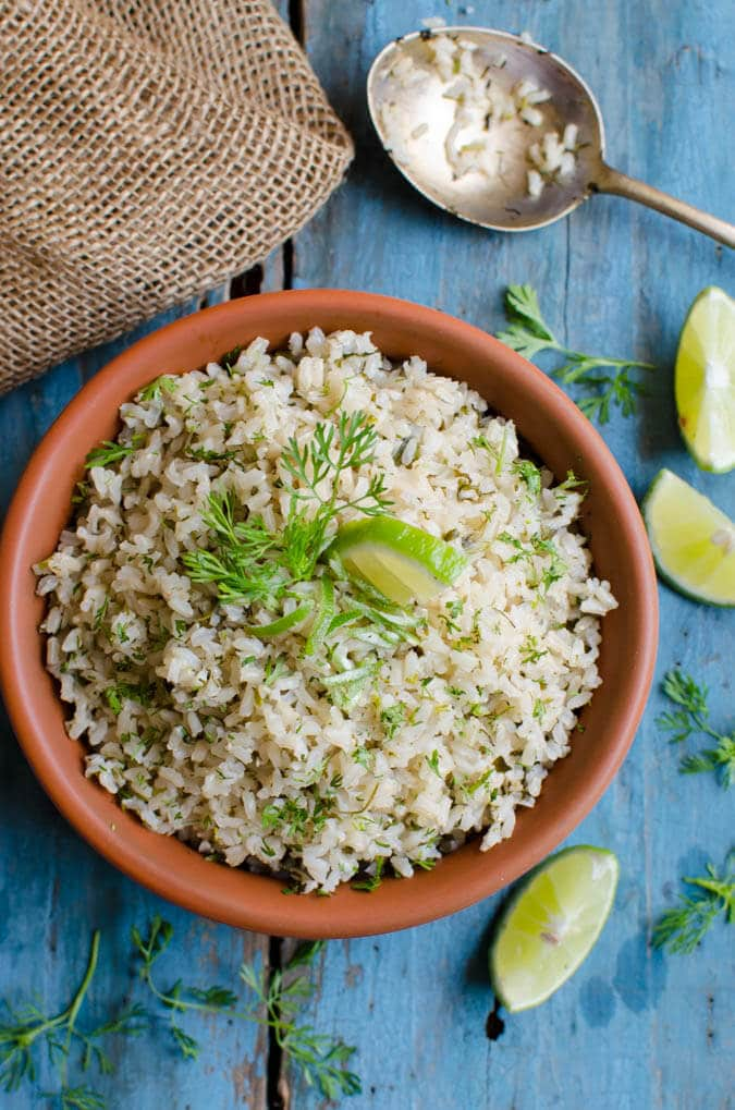 This healthy cilantro lime brown rice pairs perfectly with many Mexican dishes. It is healthy, vegan and gluten free. | watchwhatueat.com