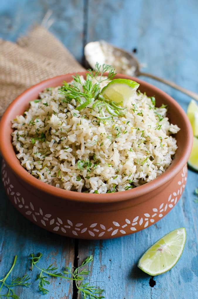 Once you try this cilantro lime brown rice recipe, I am sure you will start loving brown rice. It is also vegan and gluten free. | watchwhatueat.com