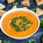 Easy homemade hummus prepared using roasted red peppers. @watchwhatueat