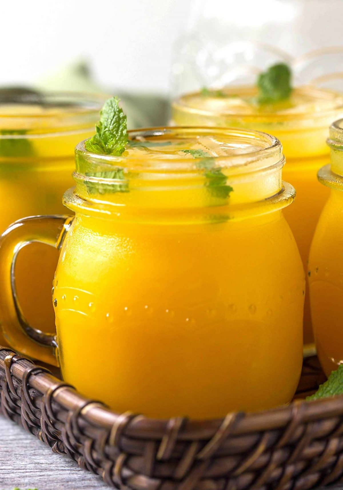 Refreshing mango lemonade to enjoy hot summer days. Prepared using fresh zesty lemon juice, honey, & mango pulp. Healthy, delicious & naturally sweetened fresh lemonade