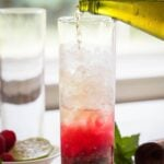 Turn fresh raspberries into this non-alcoholic Raspberry Mojito. It's a perfect drink to enjoy summer