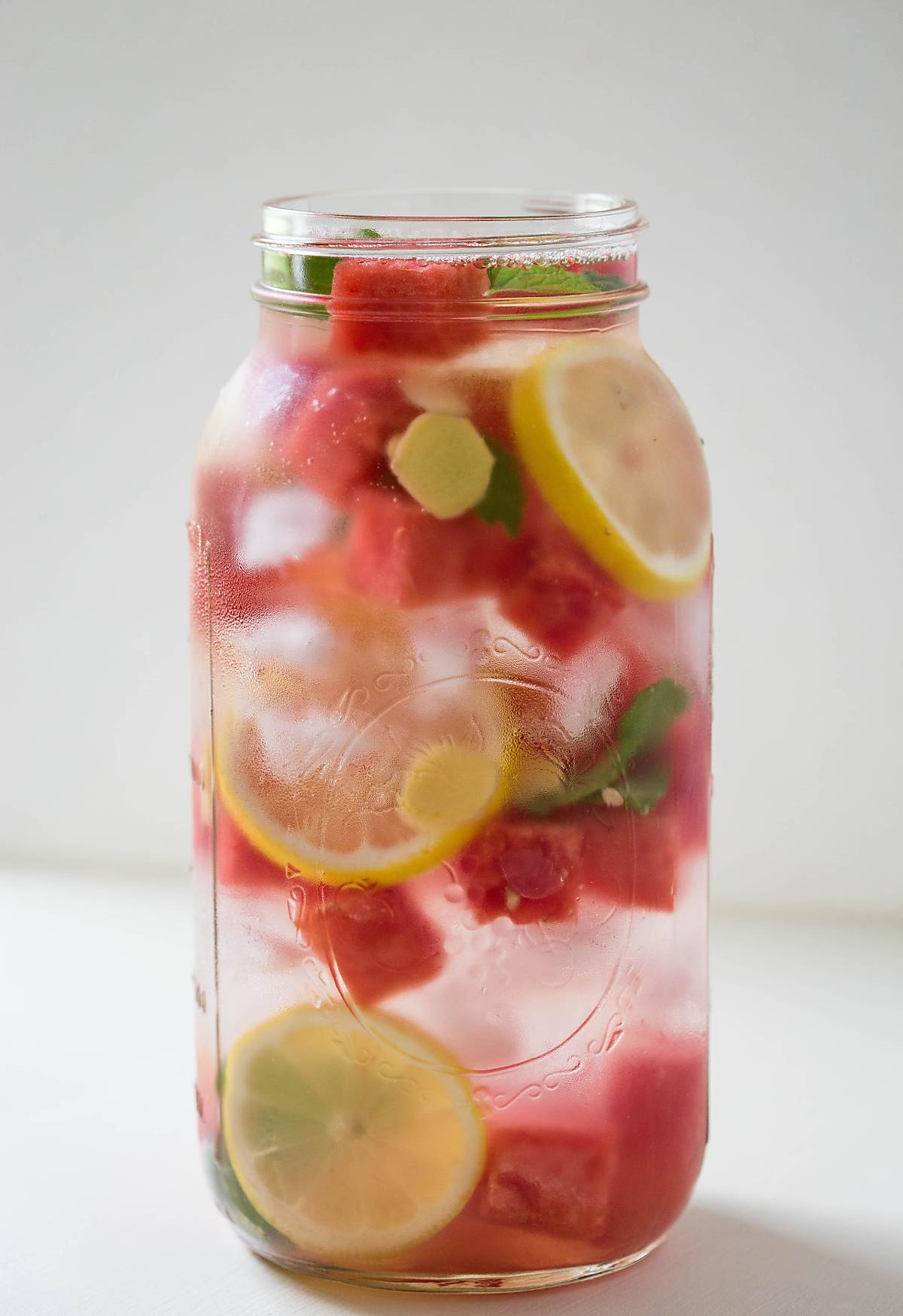 Refreshing Watermelon Detox Water - give a healthy twist to your regular drinking water with fresh watermelon, lemon, mint, and some ginger.