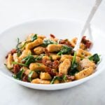 Sweet potato gnocchi with spinach and sun-dried tomatoes