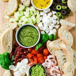 These crostini appetizers with a variety of colorful toppings are perfect for social party nights. Very easy to prepare with loads of flavors. | Holiday Crostini Platter | #crostini #partyappetizer #healthyappetizer #thanksgivingappetizer