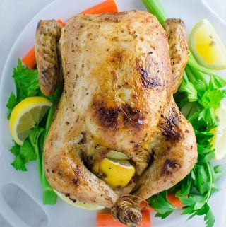 Super juicy garlic and herb roasted whole chicken you can make for your weekend family dinner or holiday party night. Super easy with quick preparation and tons of flavors.