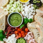 Learn four delicious recipes to make crostini appetizers. You can make it into crostini platter with a variety of toppings that includes bread, pesto, shrimp, tomato, olives, avocado, etc. Perfect party appetizers for holiday or family gatherings. | #watchwhatueat #partyappetizer #thanksgivingappetizer #crostini