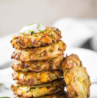 Make these healthy Zucchini Corn Fritters from fresh zucchini and corn with this simple recipe. Fry them in an Air Fryer with very little oil for healthy snacks or appetizers. #zuchhini #fritters #vegan #glutenfree #airfryer
