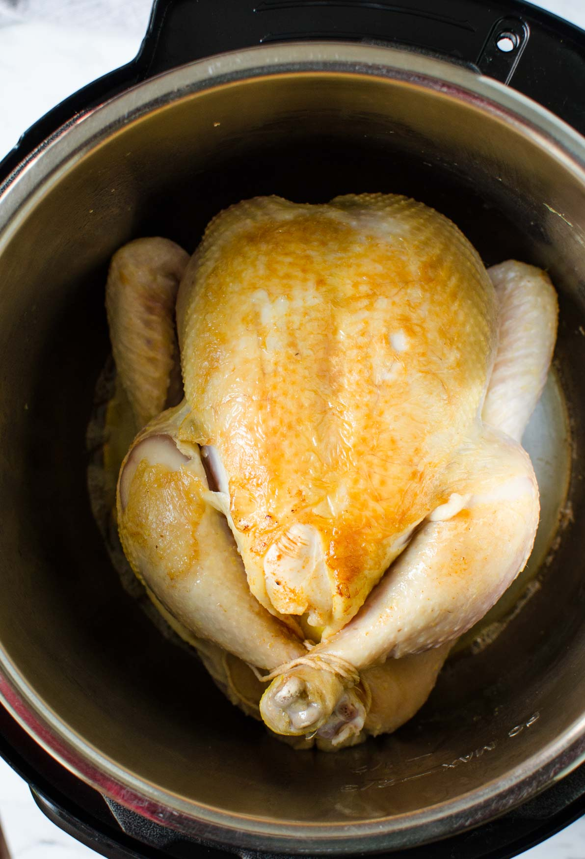 Seared whole chicken in Instant Pot.
