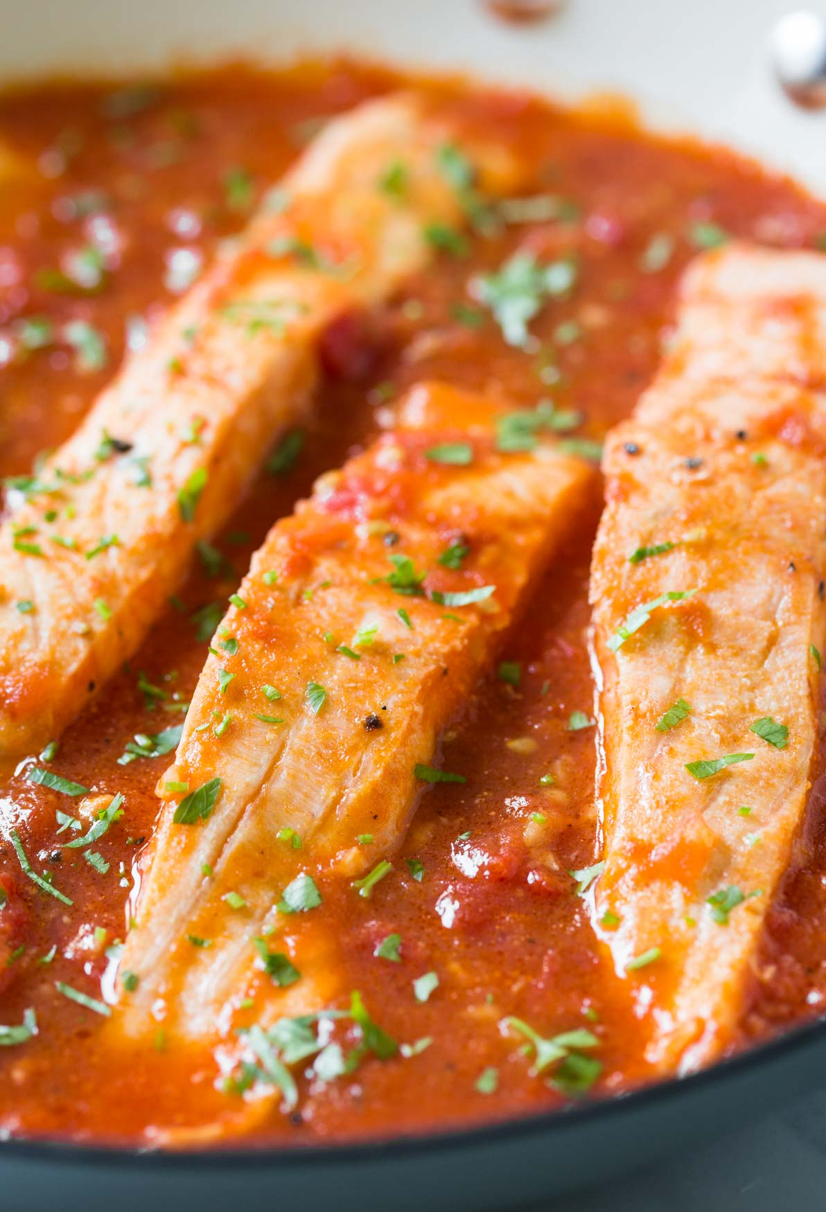 Salmon in Tomato Sauce - Under 30 min quick and easy weeknight meal. Serve with pasta, grits or plain rice.