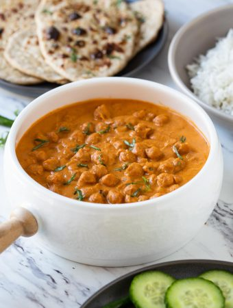 Toasted chickpeas dunked in creamy tomato authentic tikka sauce to make this easy restaurant-style healthy chickpea tikka masala.