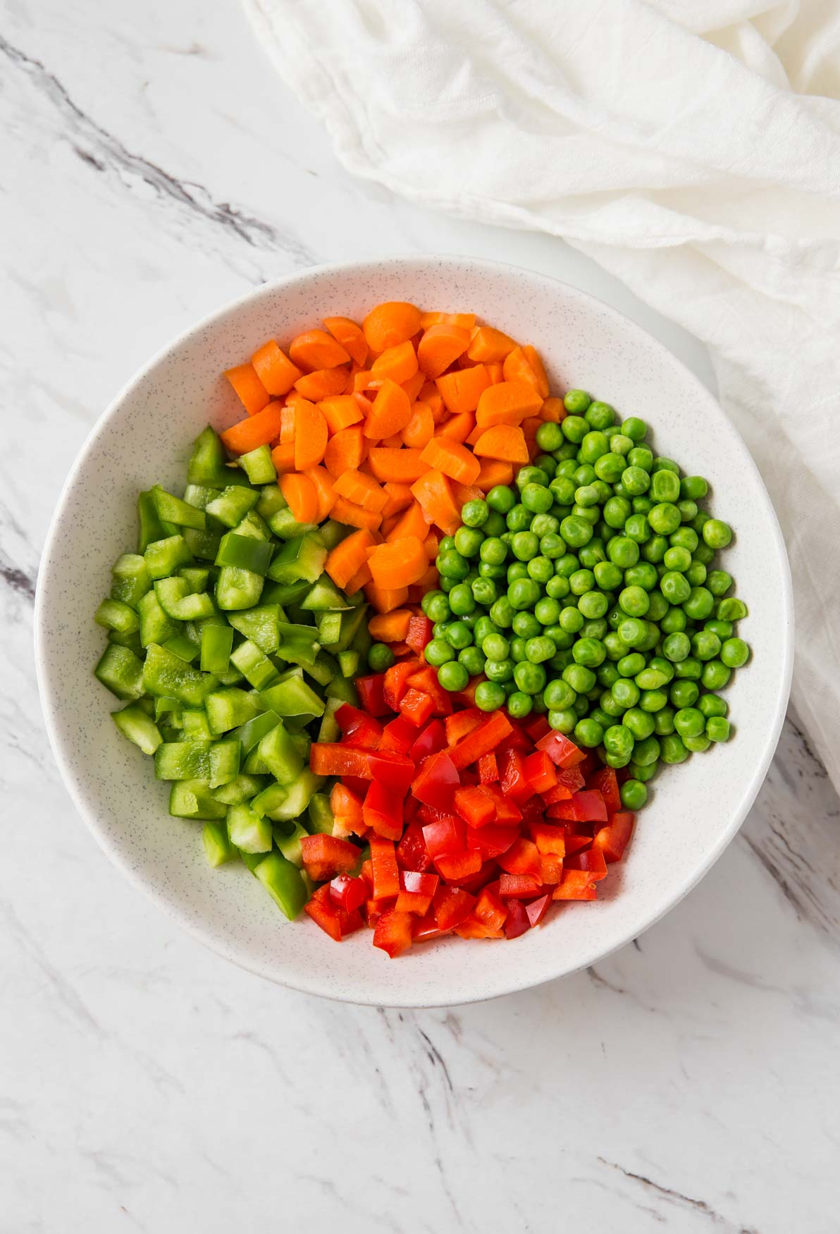 Diced fresh vegetables in a mixing bowl for making vegetable fried rice