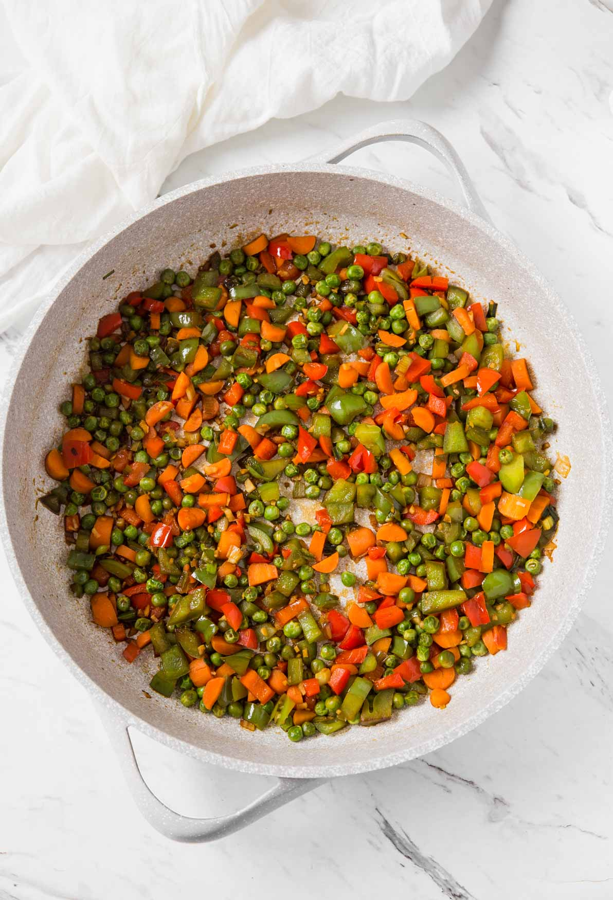 Stir-fried fresh vegetables in a large skillet for making vegetable healthy fried brown rice