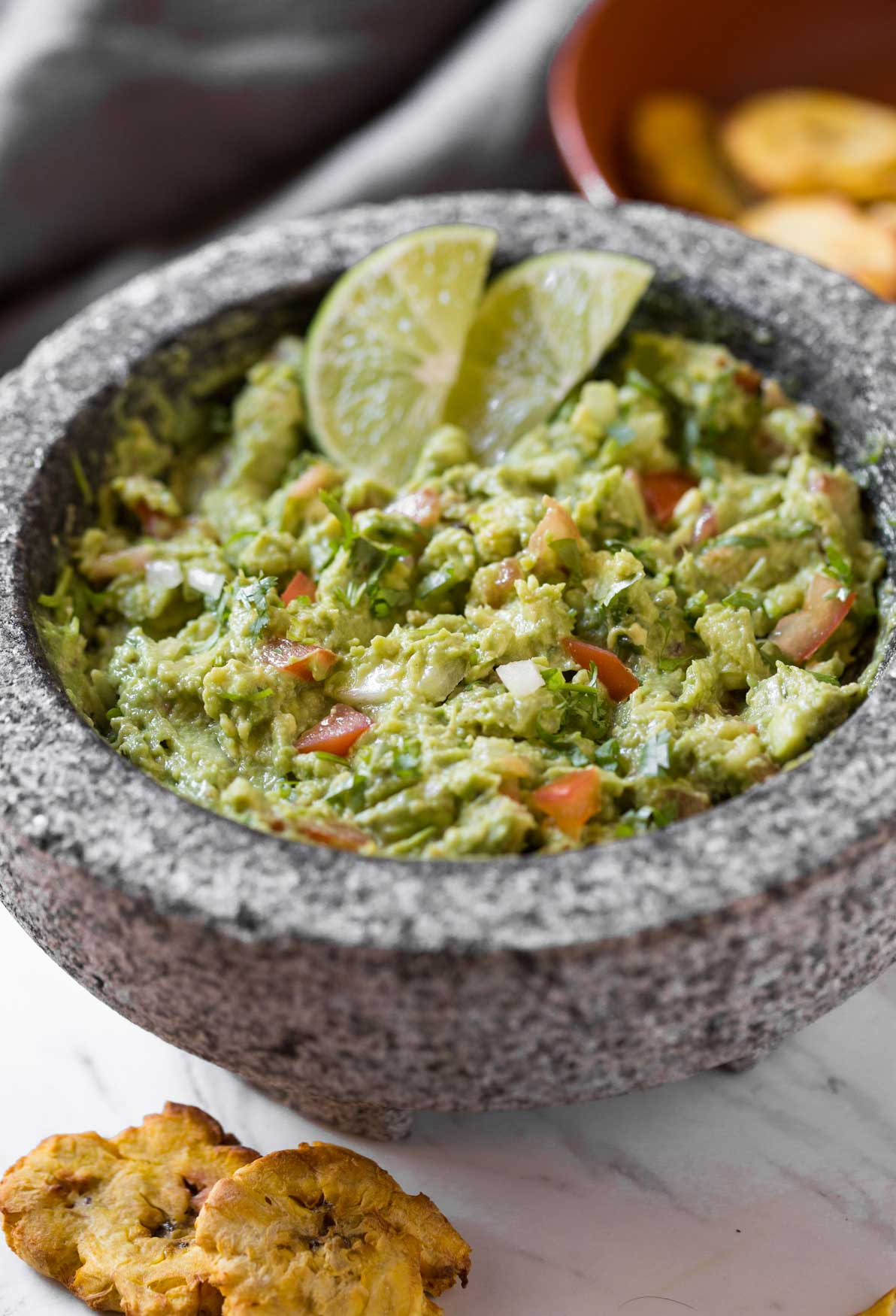 Simple Healthy Guacamole Recipe -- Chunky avocado pulp mixed with fresh chopped tomatoes and onion. Lime juice, fresh cilantro, and seasonings make it even more flavourful.