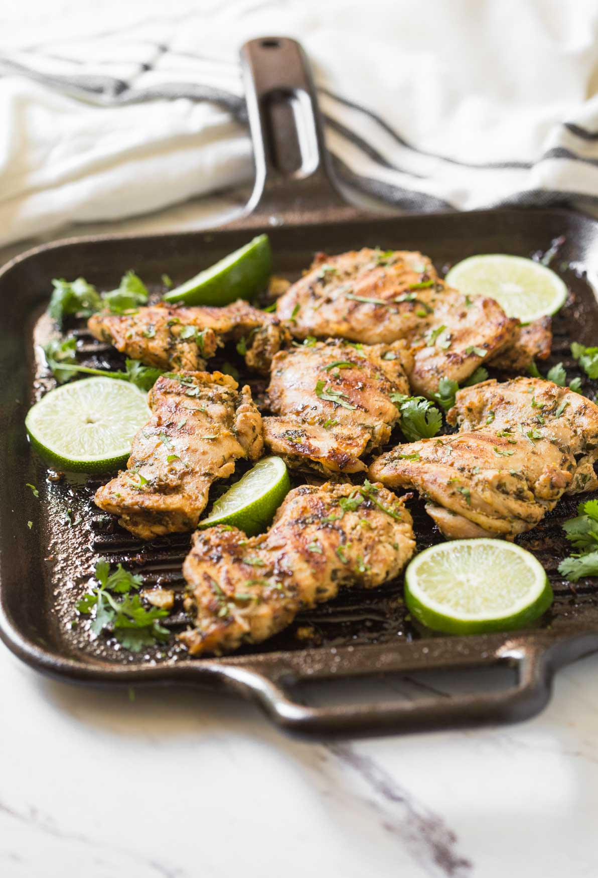 This grilled cilantro lime chicken thighs recipe is perfect to add in the outdoor barbecue party menu during summer. Prep ahead in no time and take them to barbecue potlucks. Or just cook marinated chicken on the grill or frying pan for the weeknight dinner. | #watchwhatueat #grilledchicken #cilantrolime #grilling #chickenthighs