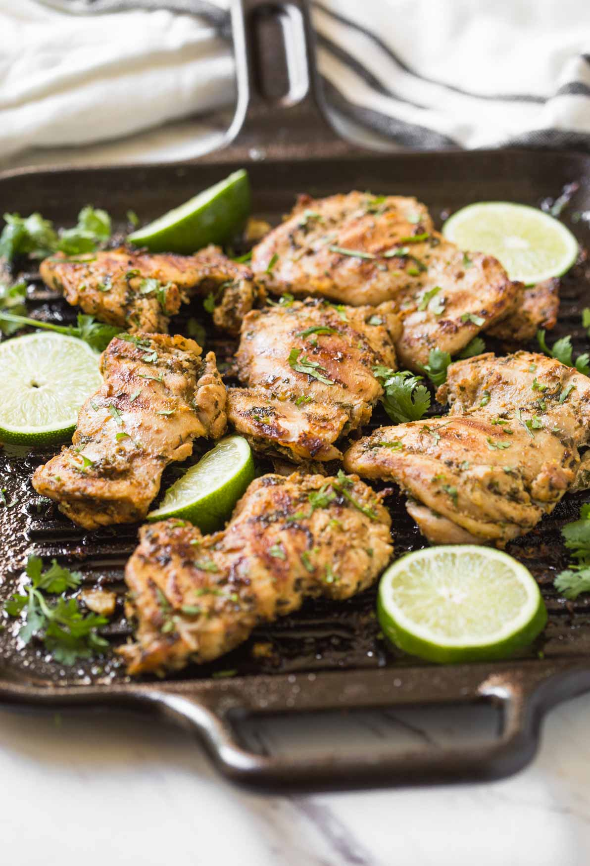 Prepare these cilantro lime grilled chicken thighs with delicious and healthy marinade. A quick and easy prep-ahead recipe perfect for a grilling party. Or just cook marinated chicken on the grill or frying pan for the weeknight dinner. | #watchwhatueat #grilledchicken #cilantrolime #grilling #chickenthighs