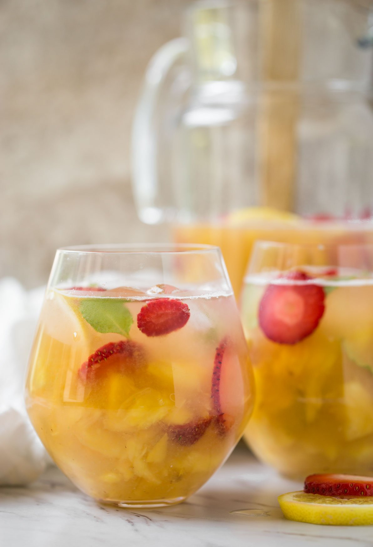 This pineapple strawberry sangria is a perfect non-alcoholic summer drink to enjoy fresh seasonal fruits and beat the summer heat. It is prepared using fresh strawberries and pineapple. | #watchwhatueat #nonalcoholic #summerdrink #strawberry #nonalcoholicsangria #sangria