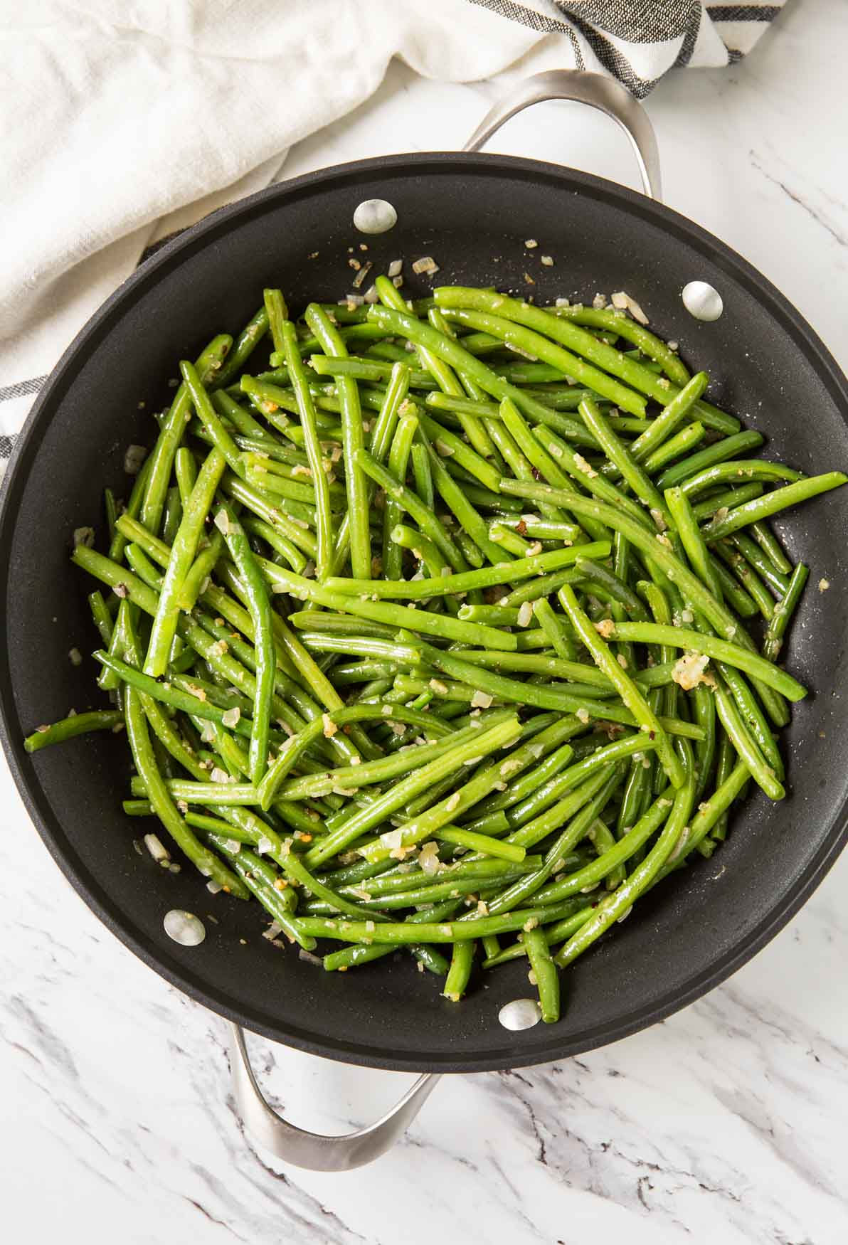 Sauteed garlic green beans in a skillet