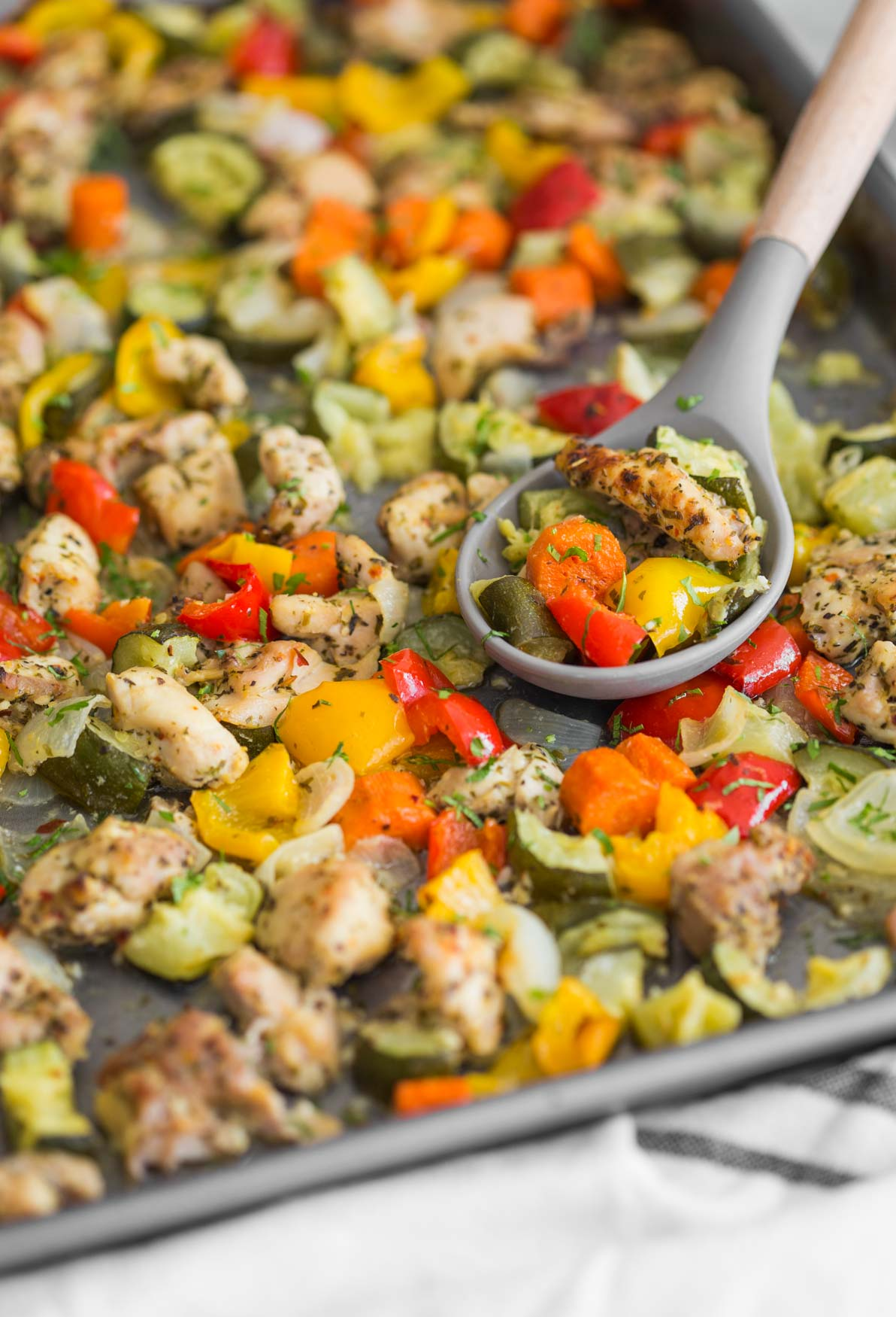 One-pan baked chicken and vegetables in a baking tray ready to serve