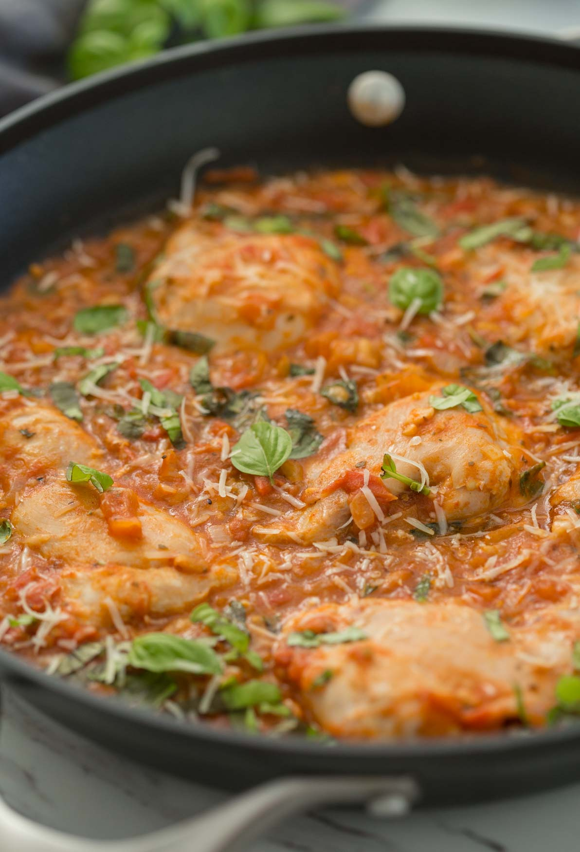 chicken in garlic basil tomato sauce in a large skillet