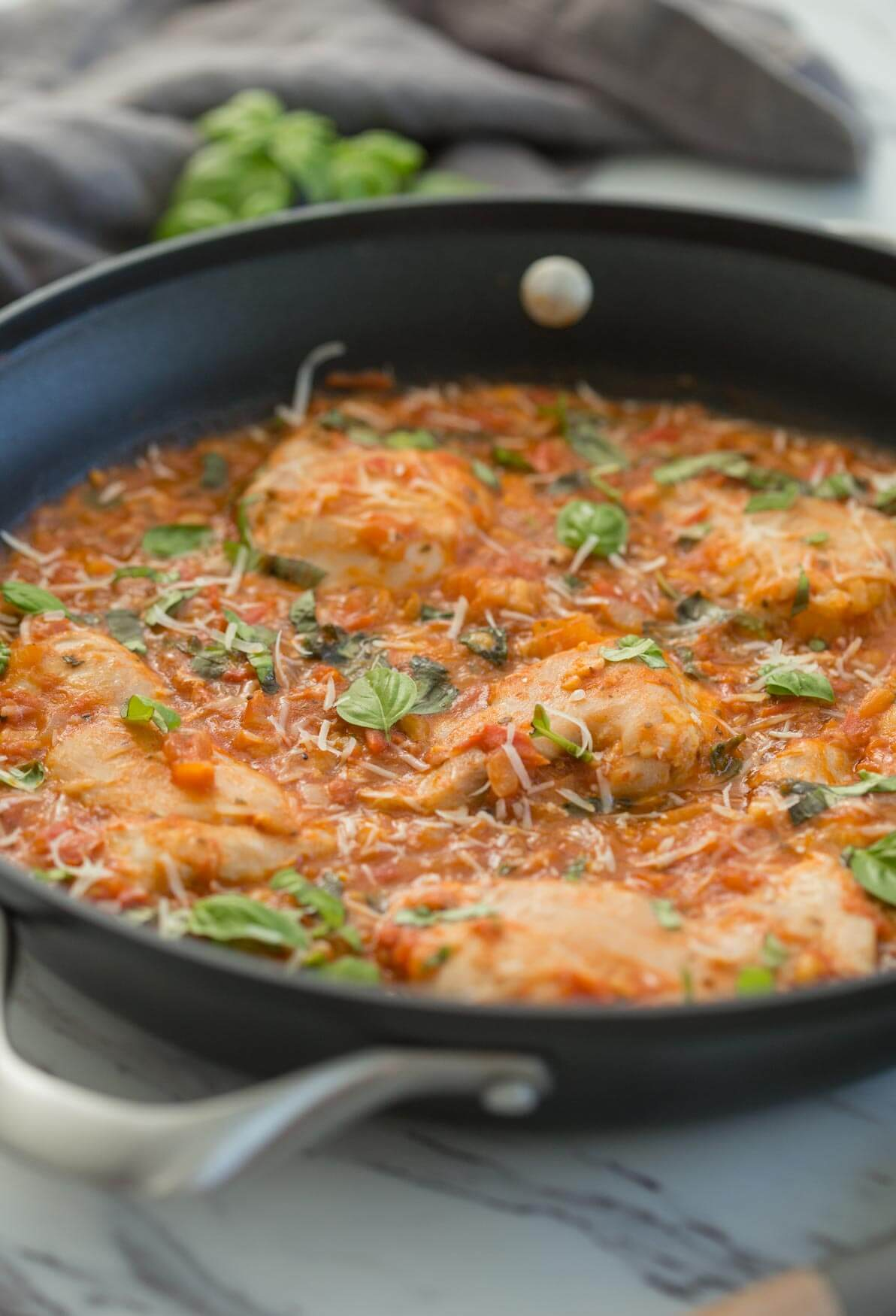 garlic basil chicken with tomato sauce in a large skillet
