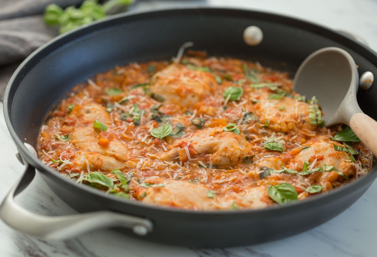 garlic basil chicken with a delicious tomato sauce in a large skillet