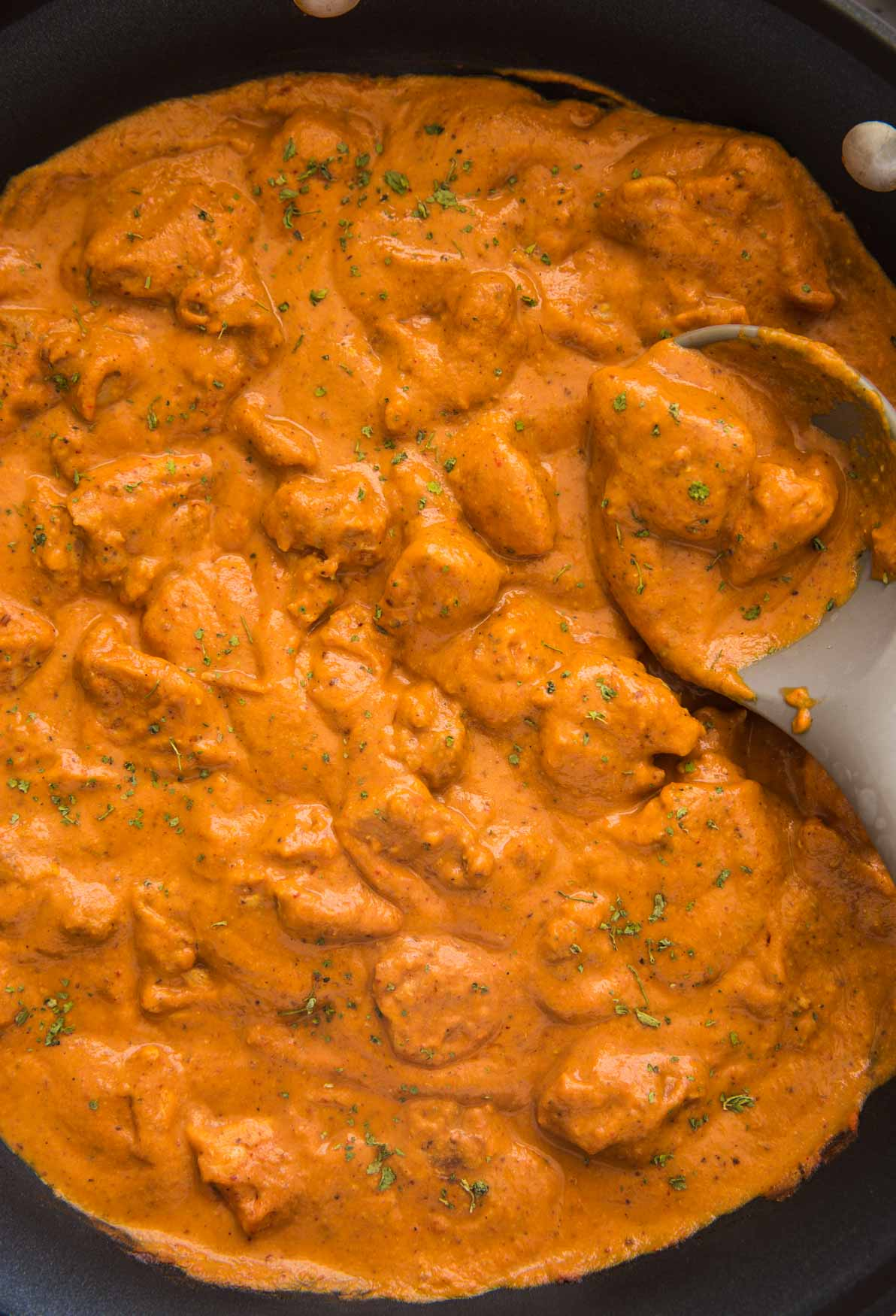 Restaurant style chicken tikka masala in a large skillet