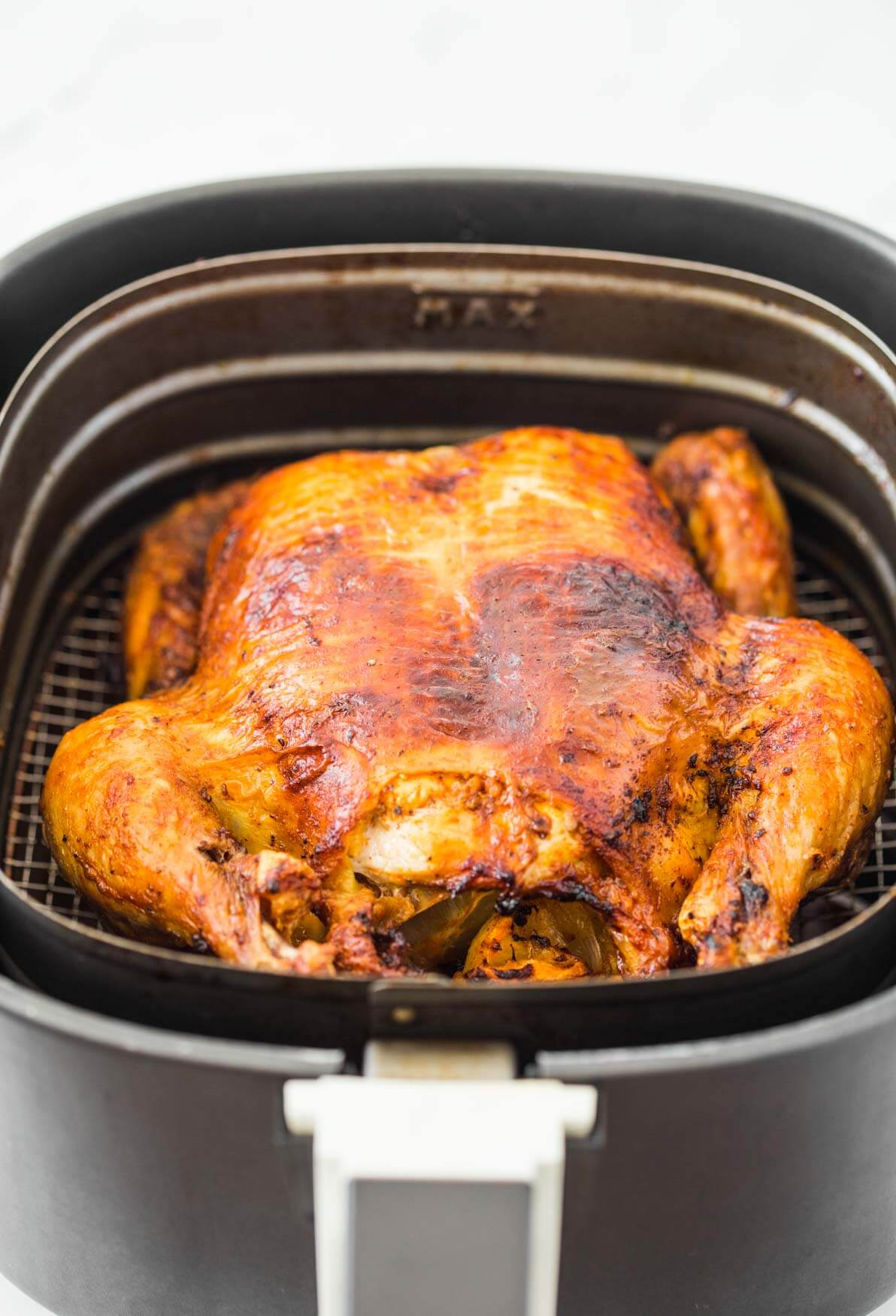 Roasted whole chicken in Air Fryer basket