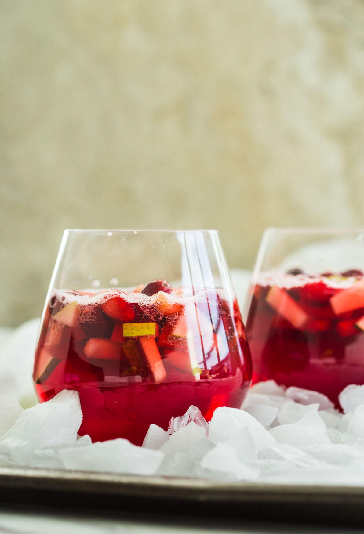 healthy cranberry sangria in serving glasses