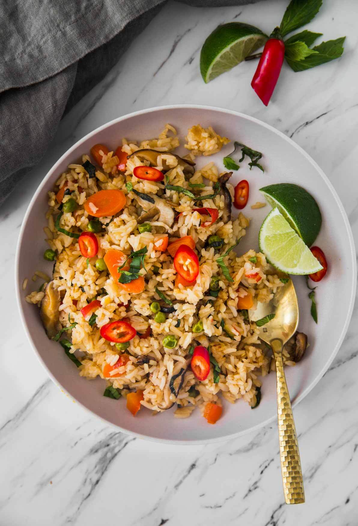 Thai fried rice with vegetables in a serving plate