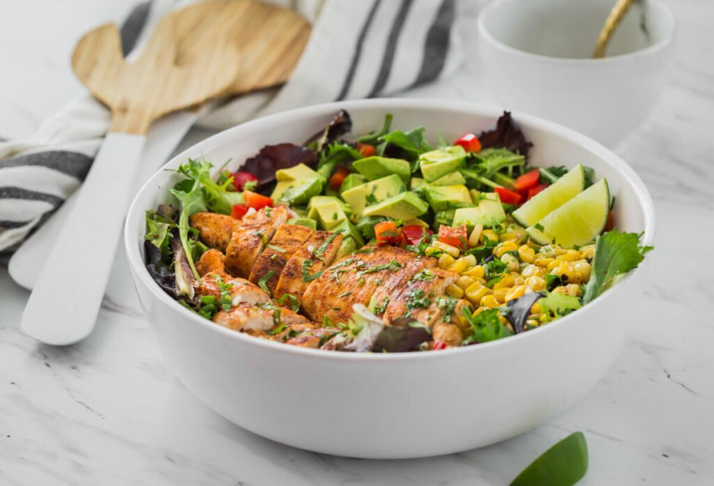 Mexican Salad with chicken and avocado in salad bowl