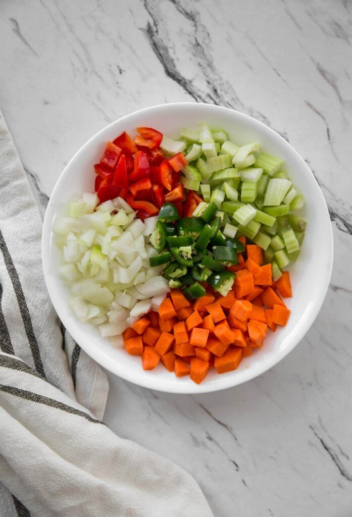 image of diced vegetables in plate for making lemon orzo chicken soup