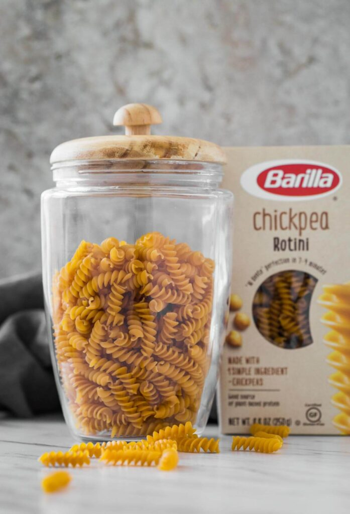 chickpea rotini pasta in a glass jar and in its package