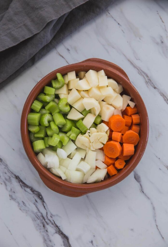 diced vegetables in a shallow bowl for making broccoli soup