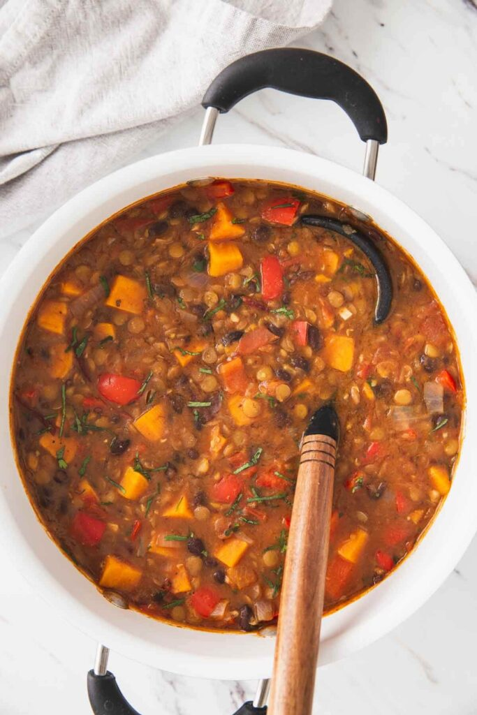 Sweet potato lentil chili prepared in a large pot and is ready to serve.